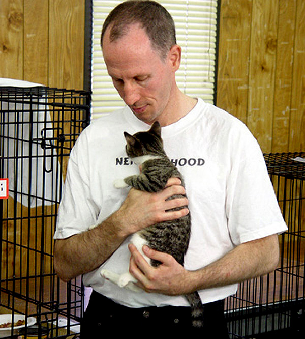 Bryan Kortis holds one of many kittens he's rescued