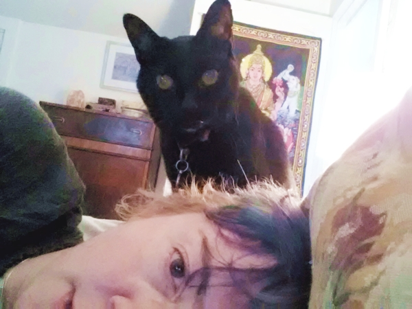 The author in bed with her cat.