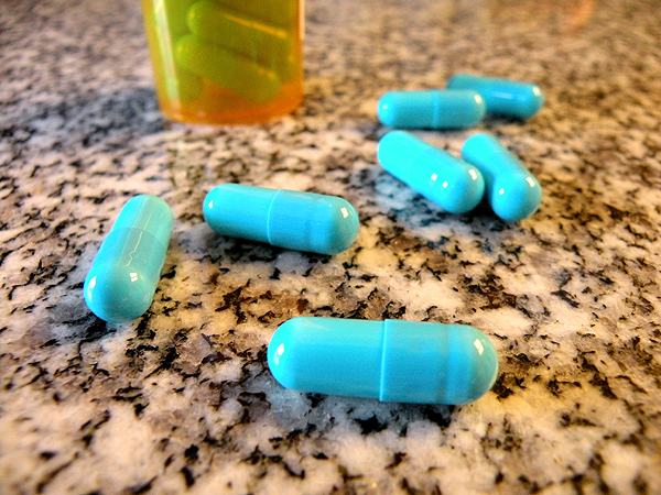Pills spilled out on a counter.