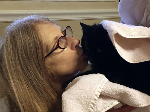 How One Little Black Cat Is Saving Her Mom's Final Days