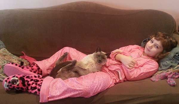Oliver and my daughter enjoying some quality time together. (Photo courtesy Debbie De Louise.)
