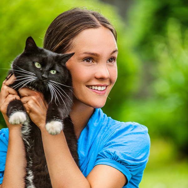 woman-holds-black-cat-293787773