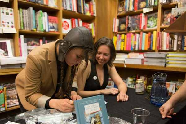 Anna (right) and Kelsey signing books at a reading in Berkeley, California.