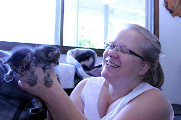 Furry Friends president Jennifer Hart cuddles some rescue kittens.