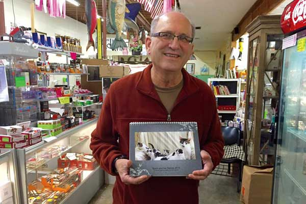 Store owner Al Richey with some cat-themed merchandise. (Photo by Angela Lutz)