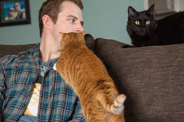 Chris with his kitties. (Photo by Gina Cioli)
