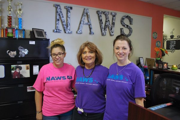 NAWS founder Goldie Arnold, center, poses with two of her volunteers.