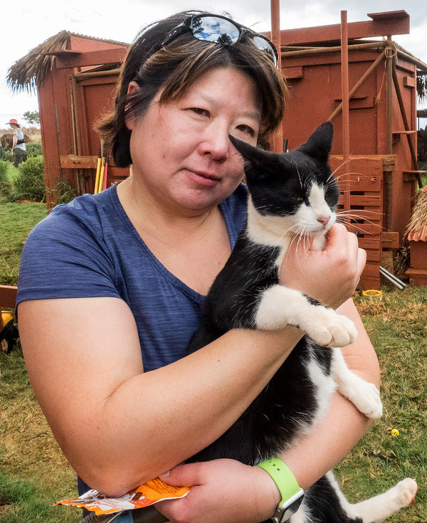 lanai-cat-sanctuary-03-woman-holds-tuxie