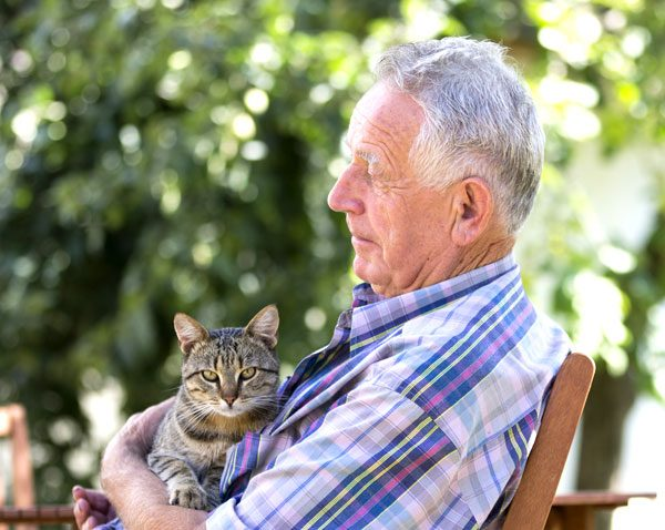 Older gentleman having a special moment with his cat.