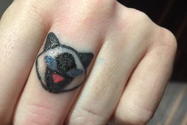 Cox's new cat tattoo