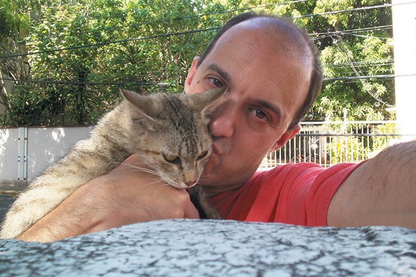 """Known as the """"Catman"""" of Puerto Rico, Glen has been feeding approximately 250 cats in his neighborhood since he moved to the island from New Jersey in 2006."""