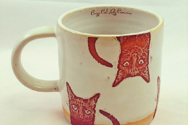 Head over to crazycatladyceramics.com for one of these work-of-art mugs.