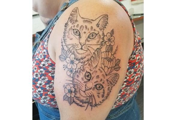 Michelle Matthews' cat tattoo.
