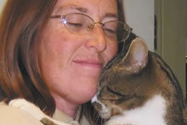 Missing Pet Partnership president Brigid Wasson with a feline friend.