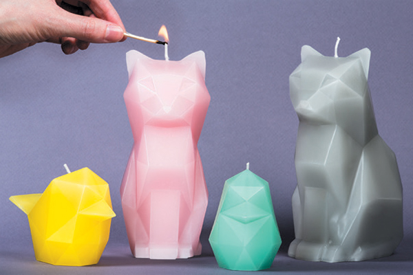 The Kisa cat candle comes in four different colors. Photography Courtesy 54celsius.com.