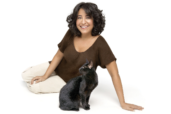 Gwen Cooper (pictured with Homer), is a New York Times best-selling author and helps educate people about blind cats.